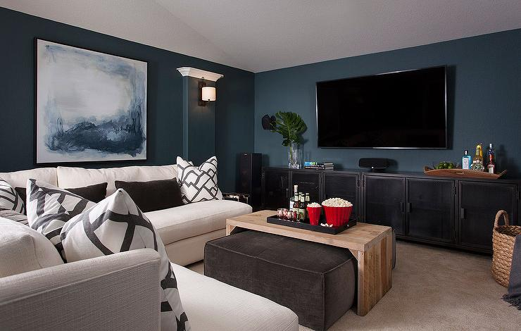 Family Room with Peacock Blue Walls and White Armless