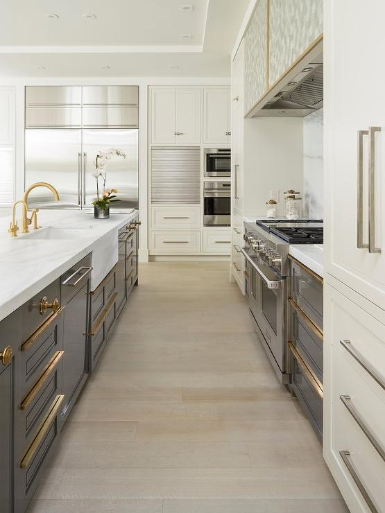 Calcutta Marble Waterfall Kitchen Island with Blond Wood