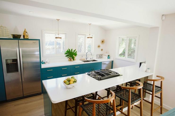 contemporary kitchen faucet amish made cabinets peacock blue with mirrored ...