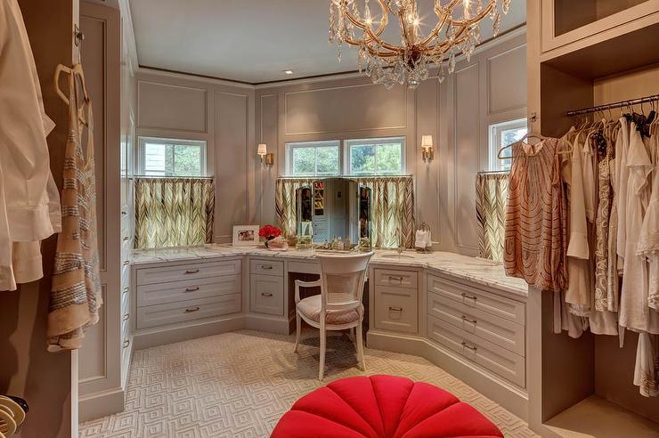 Gray Walk In Closet with Makeup Vanity Below Window