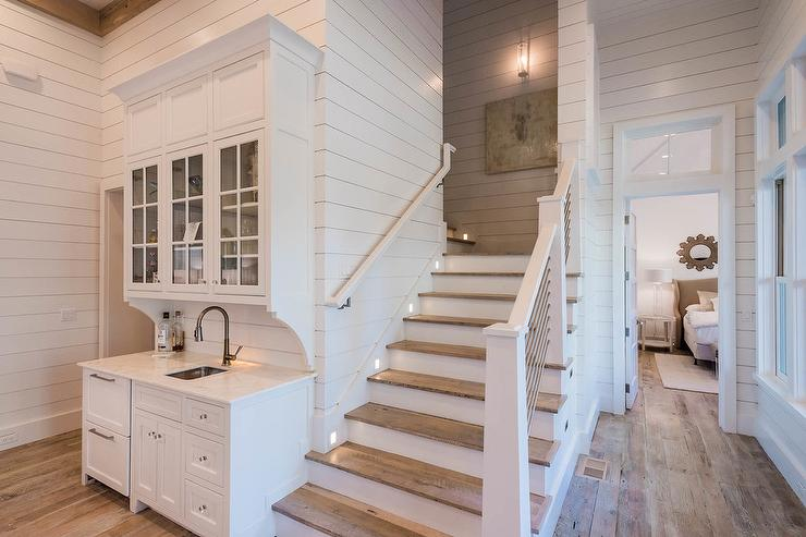 all wood kitchen cabinets backsplash stick on tiles beach bungalow wet bar next to staircase - cottage