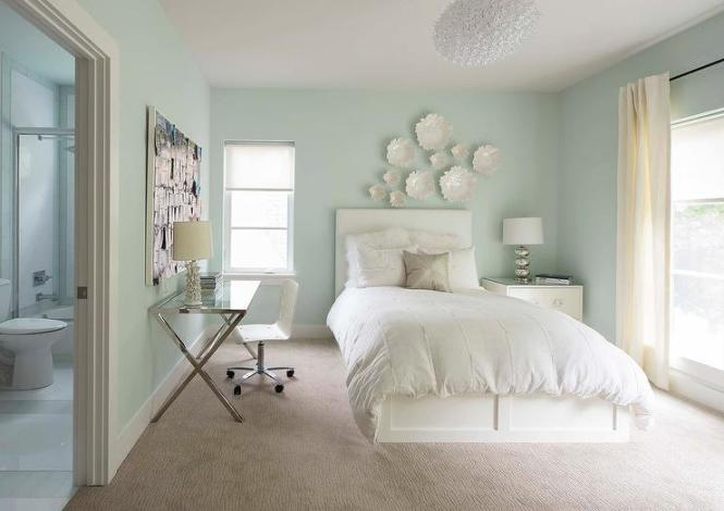 Soothing And Restful Blue Bedroom Is Lined With Pastel Walls Framing A Window Dressed In Cream Curtain Hung From Thin Iron Rod White Rolling