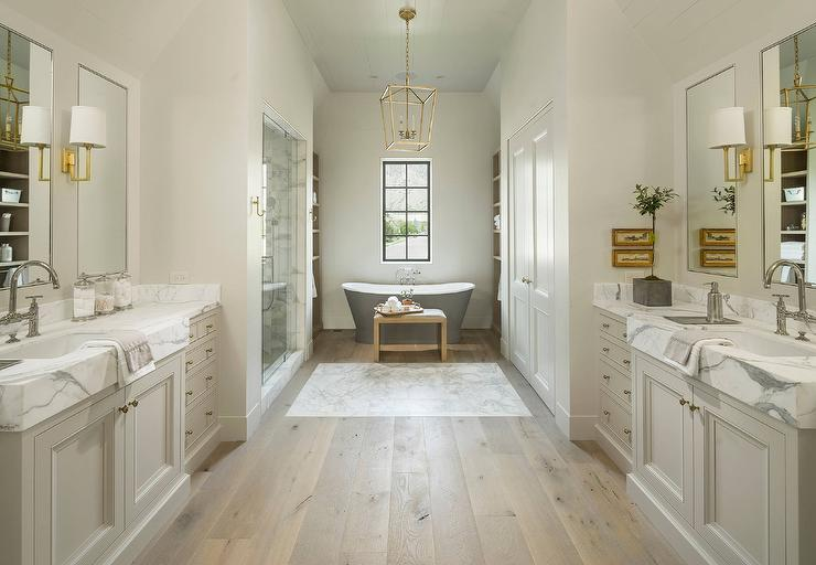 Pale Gray Washstands Facing Each Other Across From Pine Wood Floors Transitional Bathroom