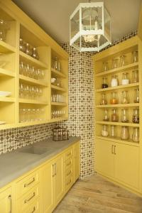 Mustard Yellow Kitchen Pantry Cabinets with Concrete