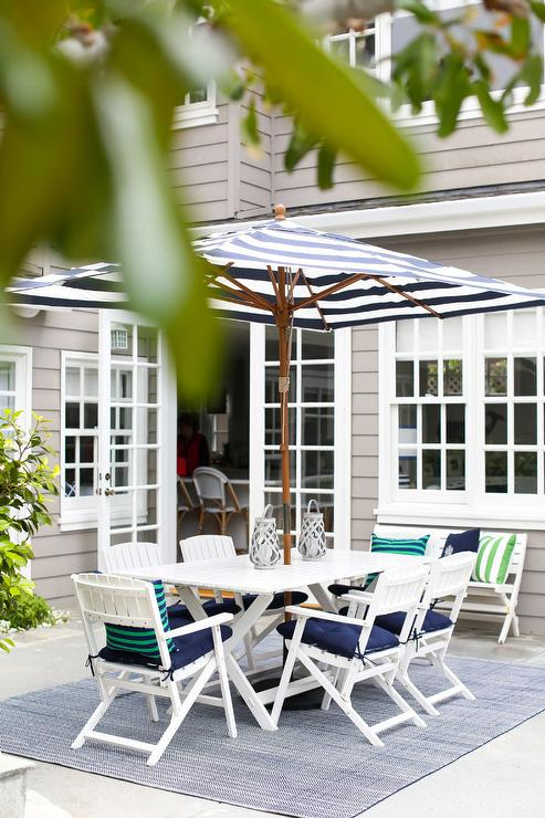 white x based outdoor dining table and
