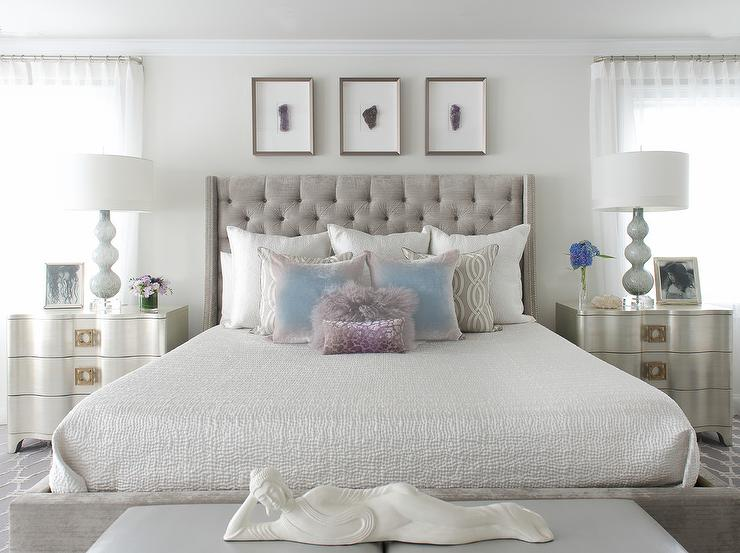 gray velvet tufted bed with silver