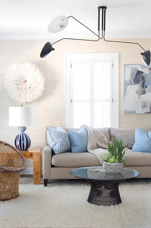 Gray Sofa with Blue Pillows and White Juju Hat