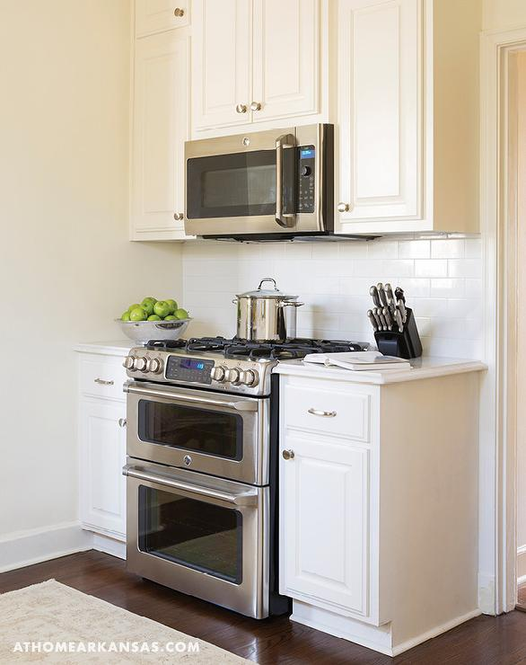 white kitchen with over the stove