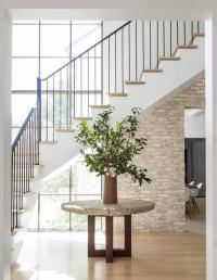 Minimalist Foyer with Round Concrete Table Under Staircase ...
