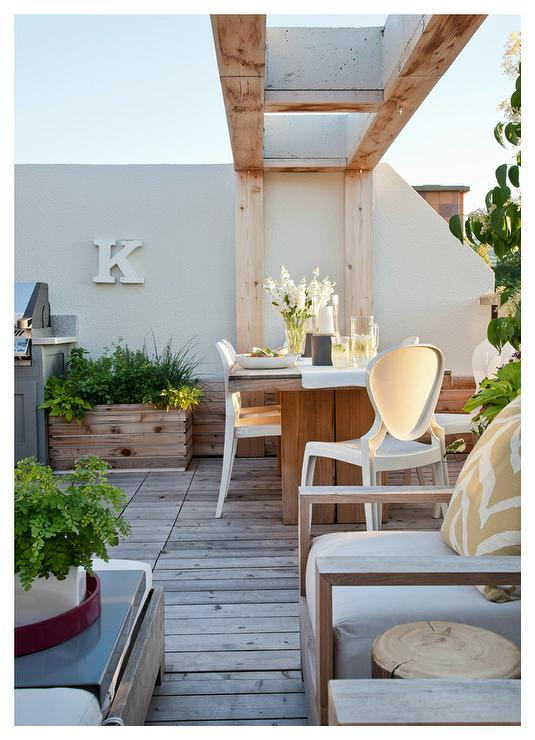 Teak Outdoor Dining Table with Modern White Chairs