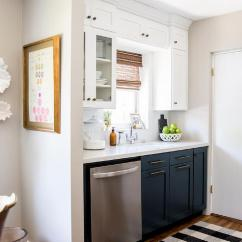 Blue Kitchen Rugs Sears Navy Lower Cabinets Design Ideas Small White And Boasts A Black Plaid Rug Positioned On Hardwood Floors In Front Of Shaker Completed With