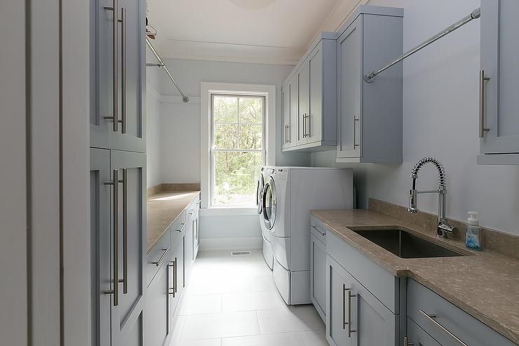 Gray Laundry Room Cabinets with Long Brass Pulls