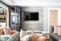 Taupe and Orange Living Room with Barn Board TV Wall ...