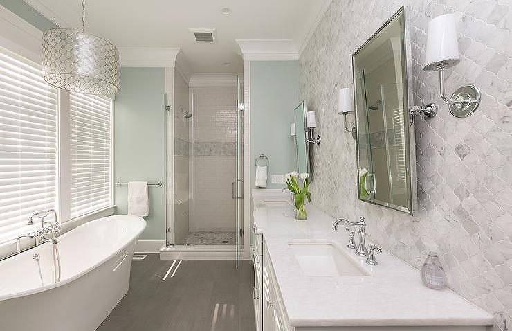 White and Blue Spa Like Bathroom with Gray Wood lIke Floor