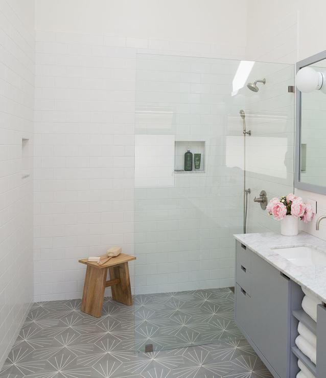 white and gray master bath with cement
