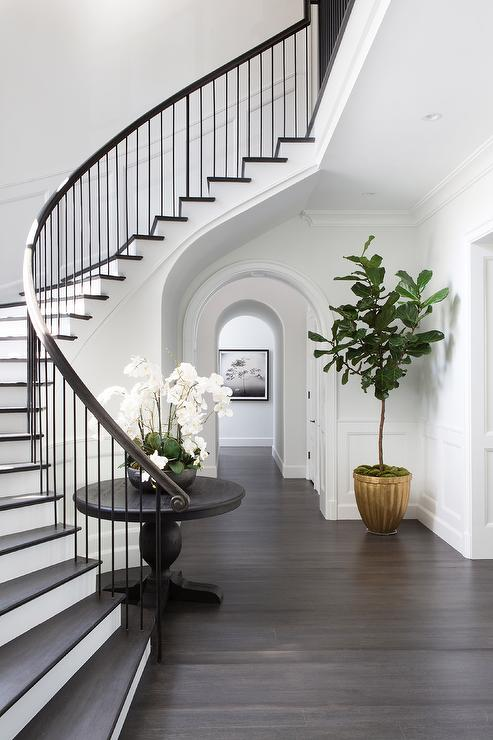 Curved Staircase Wall With Black Round Table Transitional Entrancefoyer