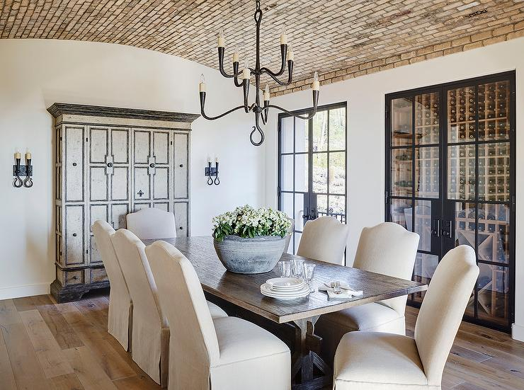 oval back dining chairs wheelchair graphic elegant room with brick herringbone barrel ceiling - transitional