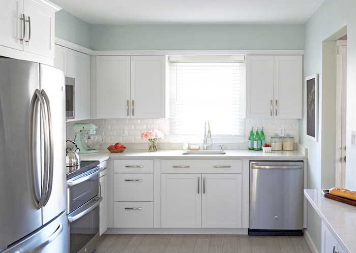 white kitchen cabinets lowes commercial sink drain parts arcadia design ideas gorgeous u shaped features walls painted in valspar winter paris lined with lowe s mounted against american olean starting line