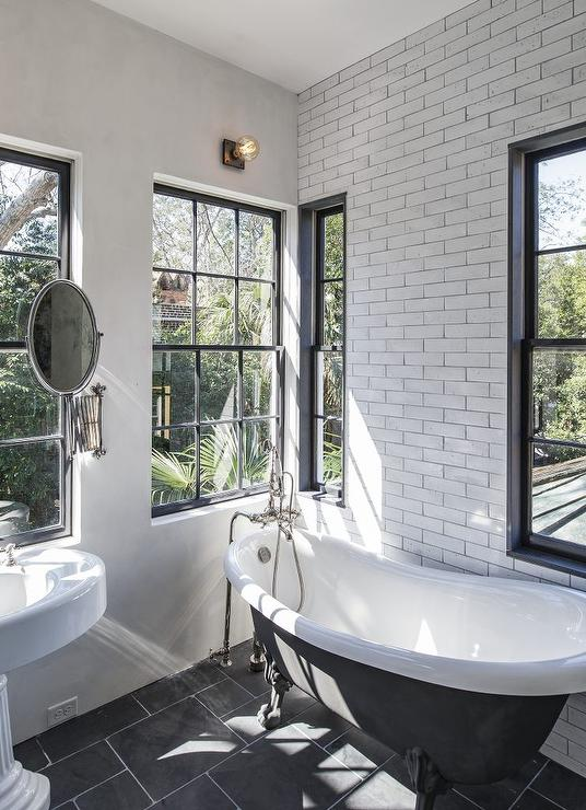 Black And White VIntage Bathroom With Black Claw Foot
