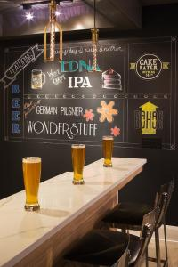 Marble Top Basement Bar with Chalkboard Accent Wall