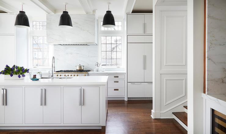 White Kitchen With French Stove And Marble Dome Vent Hood