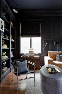 Black Beadboard Den Walls with Black Built In Bookshelves ...