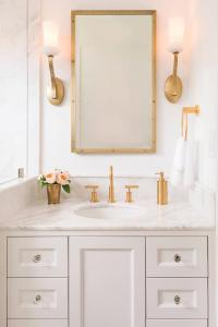 White Washstand with Brass Up Light Wall Sconces ...