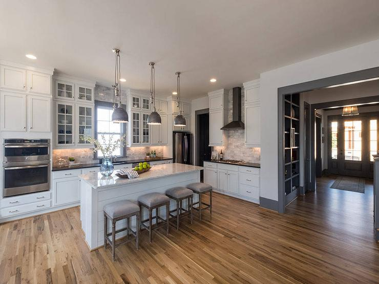 White Upper Cabinets and Black Bottom Cabinets with French