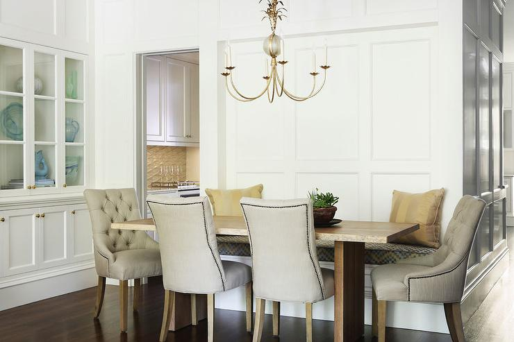 beige tufted nailhead dining chairs