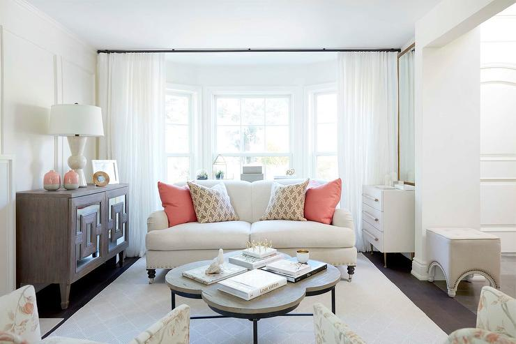 Living Room Bay Window With White Curtains With Gray Trim