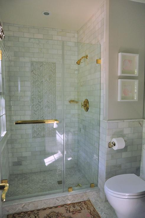 Marble Shower with Glass Door and Brass Hardware