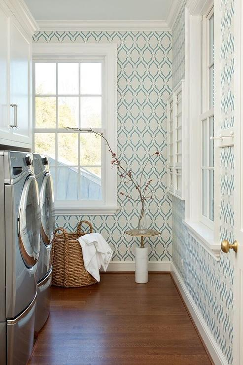 Eclectic laundry room with clothespin stencil yellow walls