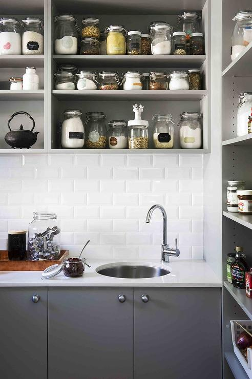 kitchen window treatments above sink delta talbott faucet gray spice shelves with flat front cabinets ...