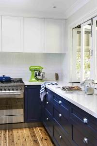 Navy Lower Kitchen Cabinets with Long Brass Pulls ...