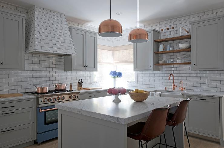 Island With Copper Light Pendants And Brown Leather Bar Stools Transitional Kitchen