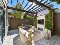 Backyard with Gray Pergola and Gray Privacy Fence ...