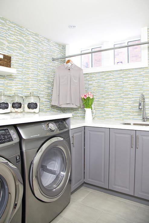 Laundry Room Sink Next to Washer and Dryer  Transitional