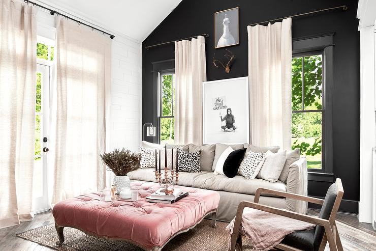 black accent wall with pink velvet