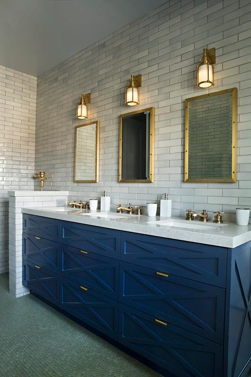 Blue Sink Vanity with Three Sinks and Brass Faucets