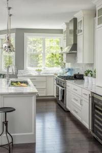 Gray Kitchen with Backless Wood and iron Stools ...