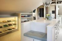 White and Gray Walk In Closet with Mirrored Closet Doors ...