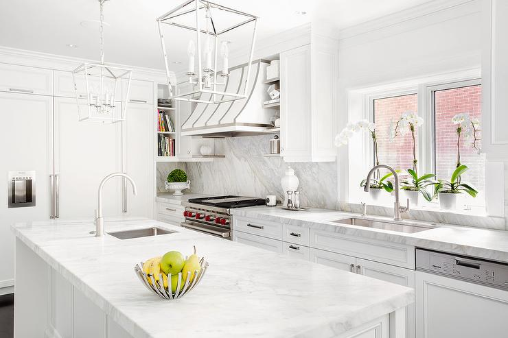 Polished Nickel Darlana Lanterns Over White Kitchen Island