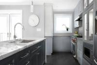 White Kitchen with Glossy Gray Linear Backsplash Tiles ...
