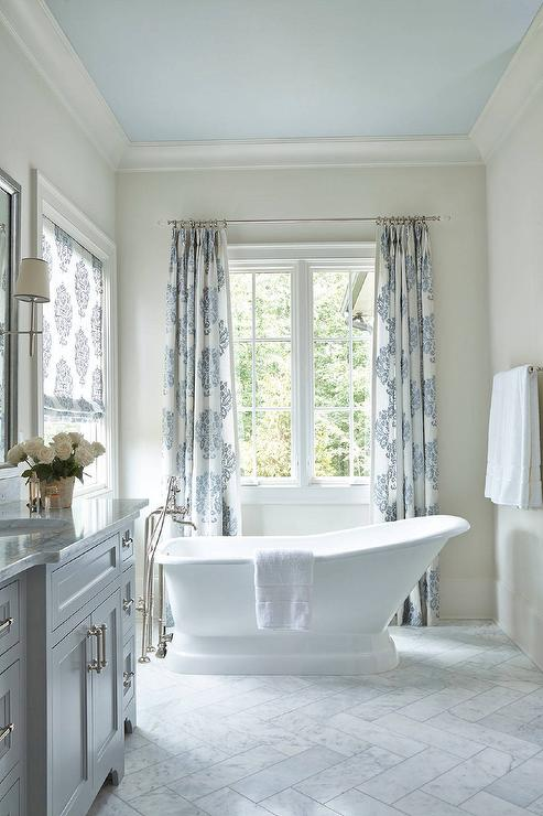 White and Gray Bathroom with Blue Painted Ceiling