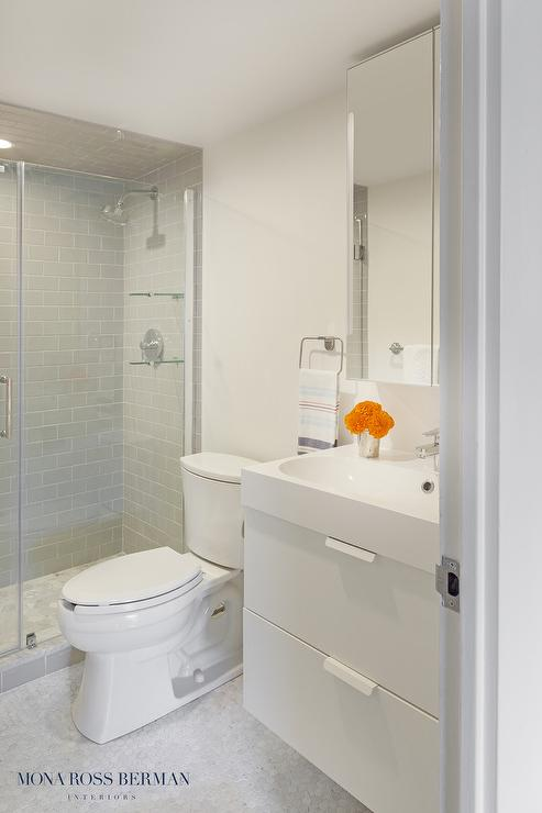 white and gray modern bathroom with floating washstand
