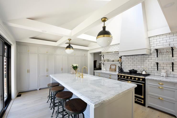 White and Gray KItchen with Black French Stove