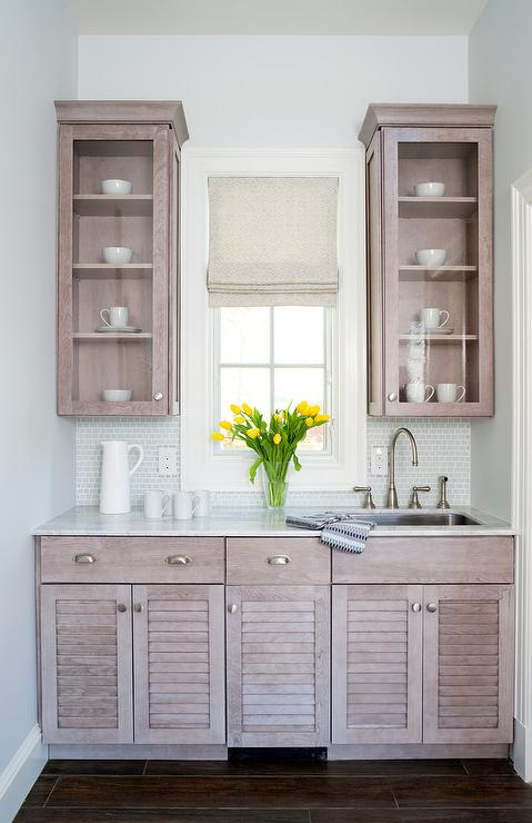 Gray Wash Butler Pantry Cabinets with Silver Backsplash