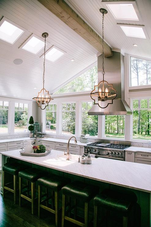 White Kitchen Cabinets With Light Gray Island Vaulted Kitchen Ceiling With Beadboard Trim - Transitional