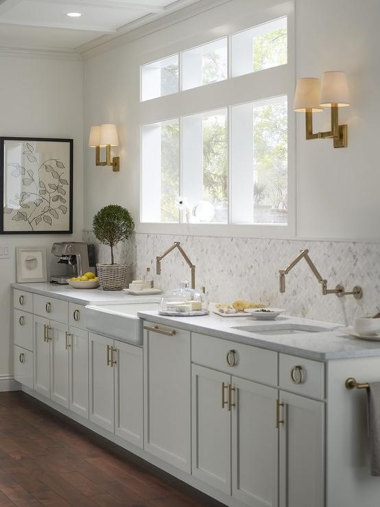 kohler brass kitchen faucet americana island extra light gray cabinets with ring hardware ...