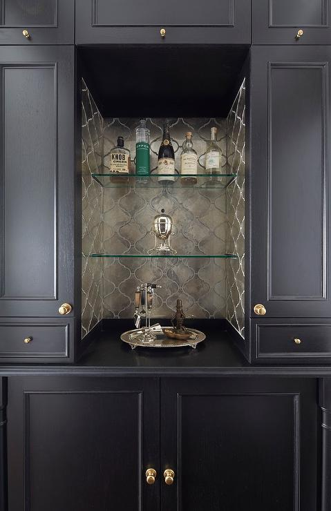 Dark Stained Bar Cabinet with Mirrored Subway Tile